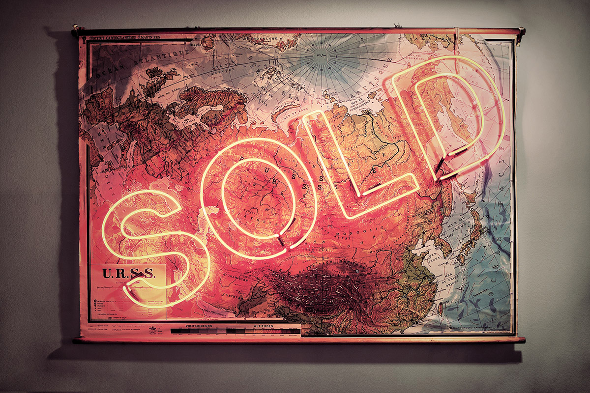 Hand-blown and coloured neon tubes on antique map