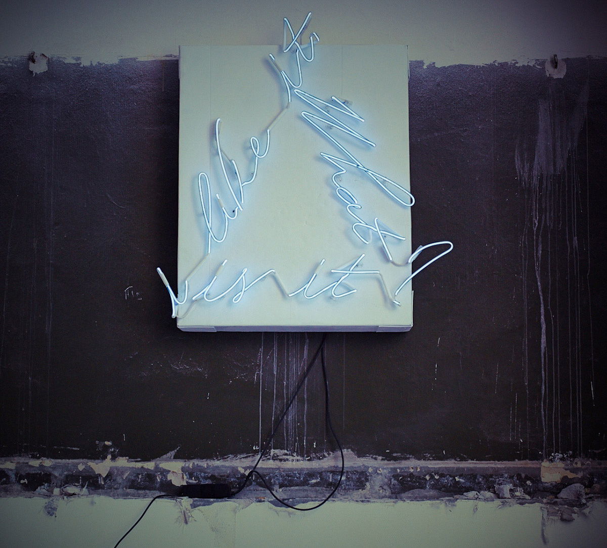 Hand-blown and coloured neon tubing on cardboard