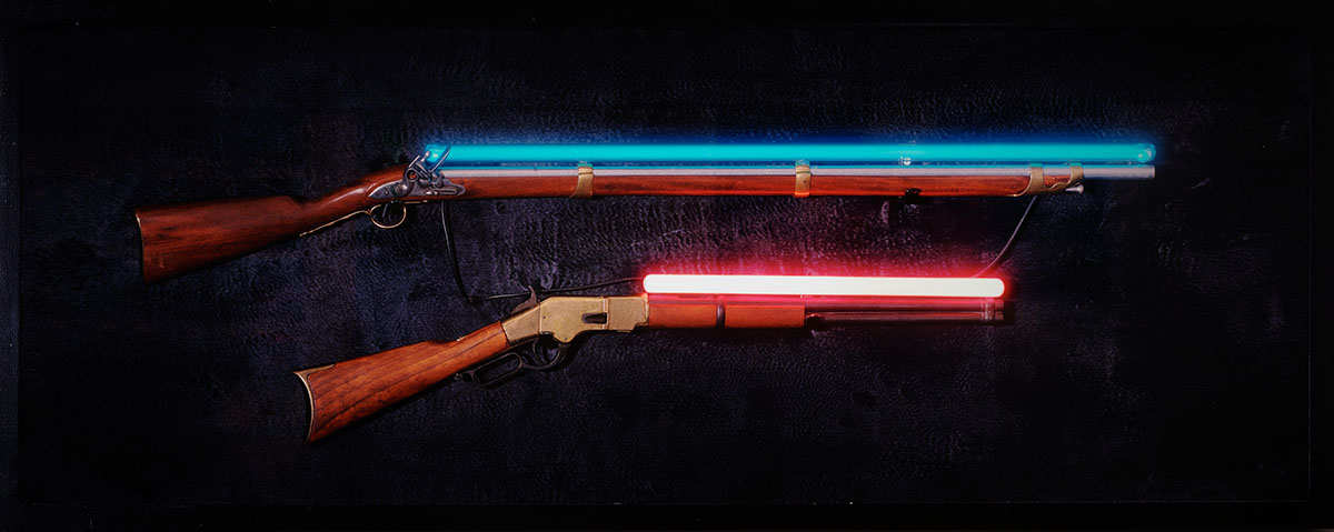 Hand-blown and coloured neon tubes, wood, velvet, antique rifles